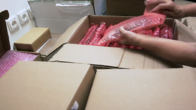 Packing circuit boards into bubble wrap for transportation video