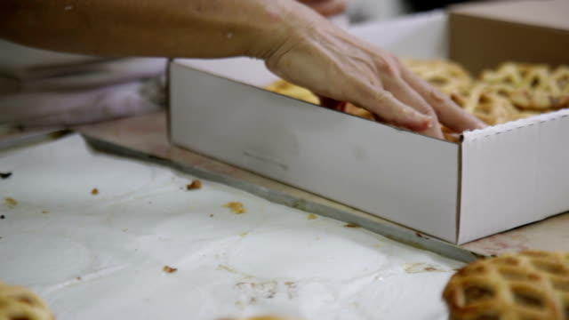 Packing fresh buns into boxes video