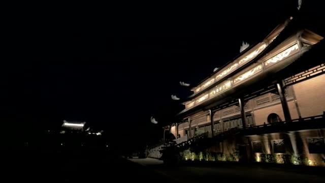 Pagoda in Bai Dinh Temple illuminated at night, Vietnam video