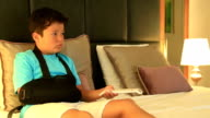 Painful child  with injured arm and bandage video