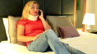 Painful woman with a neck brace talking on the phone video