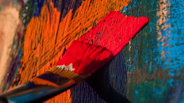 Paintbrush with oil paint on classical canvas video