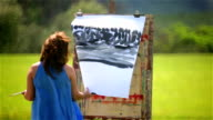 painter challenging weather conditions outdoors video