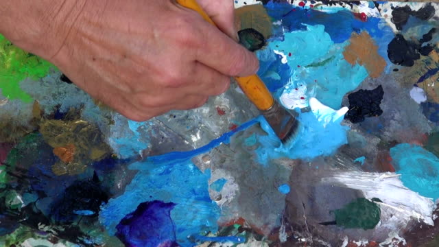 Painter mixing paint video
