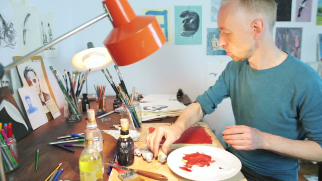 Painter working in his workshop. video