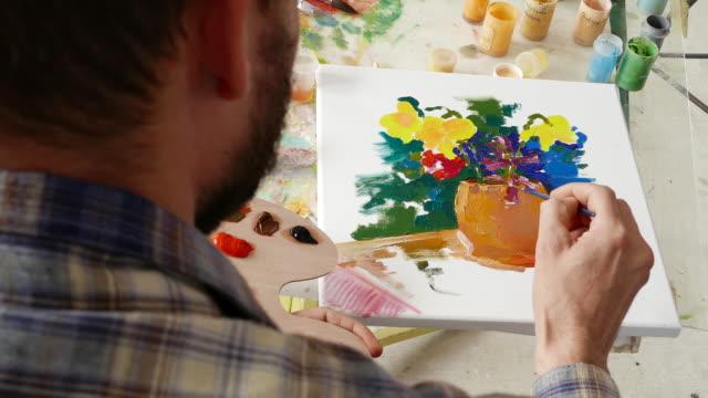 4К Painter working in studio video