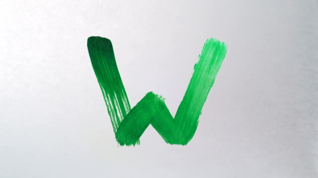 Painting alphabet on white paper, Slow Motion video