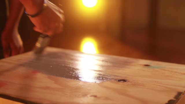 painting plywood close up video