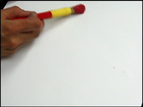 Painting red on a white background. video