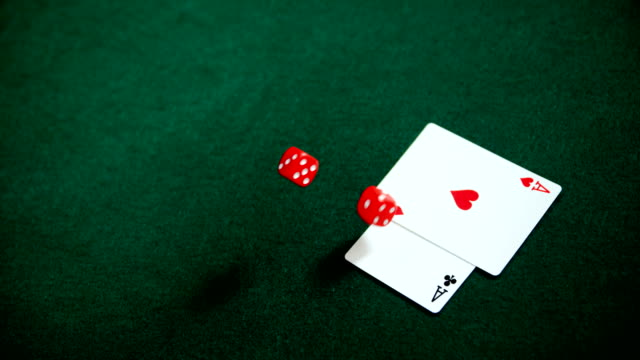 Pair of dice and playing cards on poker table 4k video
