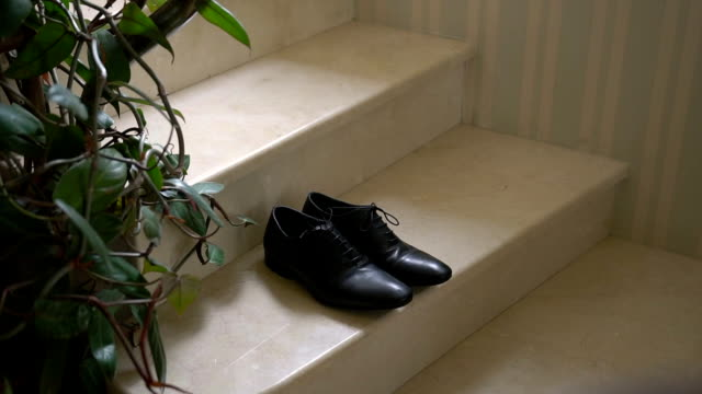 A Pair of Formal Men's Leather Shoes on a Stairs video