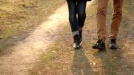 pair of legs walking in the park video