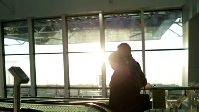 A pair of lovers of tourists on a sunny day at the airport. video