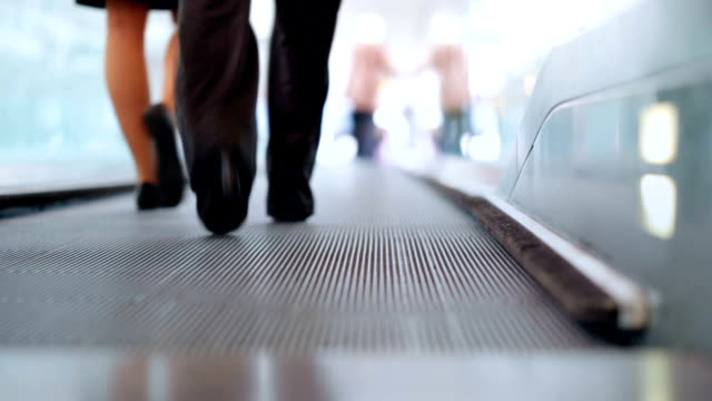 Pair on airport Moving walkway video