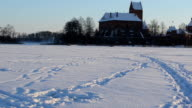 Pair snowmobile transport people Galves lake Trakai fort winter video