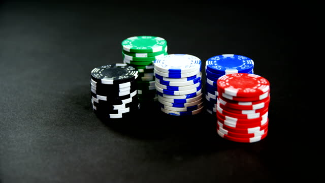Pairs of dice and casino chips on poker table 4k video
