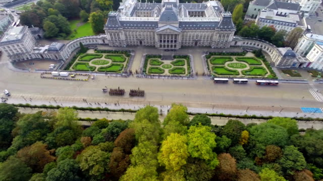 Palais Royal tourist attraction palace aerial, ceremony parade. Beautiful aerial shot above Europe, culture and landscapes, camera pan dolly in the air. Drone flying above European land. Traveling sightseeing, tourist views of Belgium. video