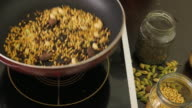 Pan across a kitchen table with various dry raw Indian spices video