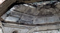 Pan down of a crumbling ruined church in Antigua, Guatemala video