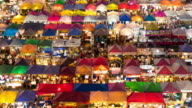 4K-UHD, Pan of people shopping in colourful night market video