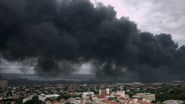 Pan of polluted smoke moving over city. video