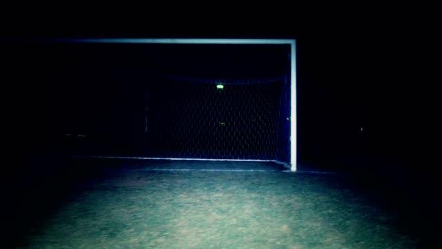 Pan of soccer net at night video