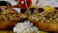 Pan of two bowls full of Olives for sale on market stall. video