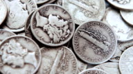 Pan over a pile of old silver dimes video