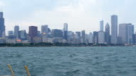 Pan panning establishing shot from Chicago skyline out to Lake michigan waterfront on a cloudy grey day video