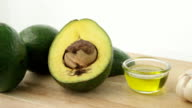 Pan shot avocado with garlic and olive oil video