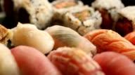 Pan shot of a variety of sushi taken with macro lens video