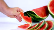 HD: Pan shot of watermelon and bunch slices video