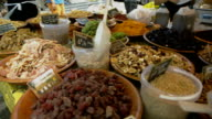 Pan to market stall feat many varieties of nuts and dried fruit for sale. video