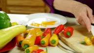 pan to woman cutting yellow pepper video