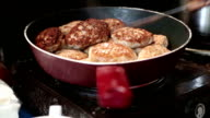 Pan with cutlets on kitchen range video