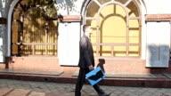 Panarama shooting men walking down the street video