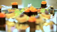 Pancakes and rolls are on the holiday table. Dynamic change of focus. Close up video