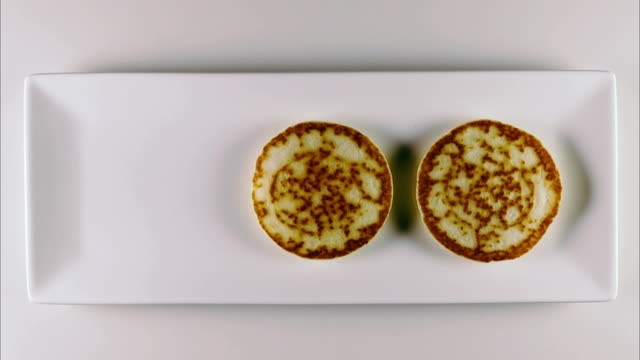Pancakes on a white rectangular plate with topping video