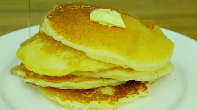 pandcake with butter and syrup. Front view. Close up. Slow motion. video