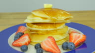 pandcake with butter  , blueberry, strawberry and syrup. Front view. Close up. video
