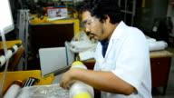 panning: a senior engineer roll blown plastic film on blown film extruder video