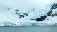 Panning Across the Frozen Antarctic Mountain Landscape video