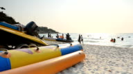panning: banana boat on the beach in evening video