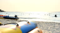 panning: banana boat on the beach in hot summer video