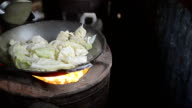 panning: cooking cabbage in a hot pan video
