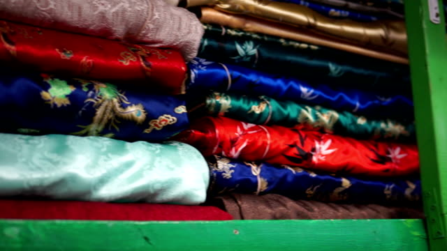 Panning from Chinese fabric to many bolts of material video