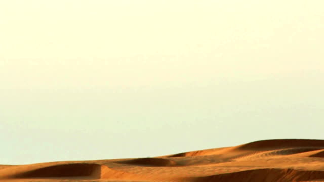 Panning from sky to dunes video
