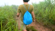 panning : men walk down from mountain peaks video