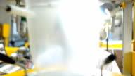 panning: senior scienctist behind extruder machine video