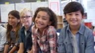 Panning shot of 5th grade kids and teacher in classroom video